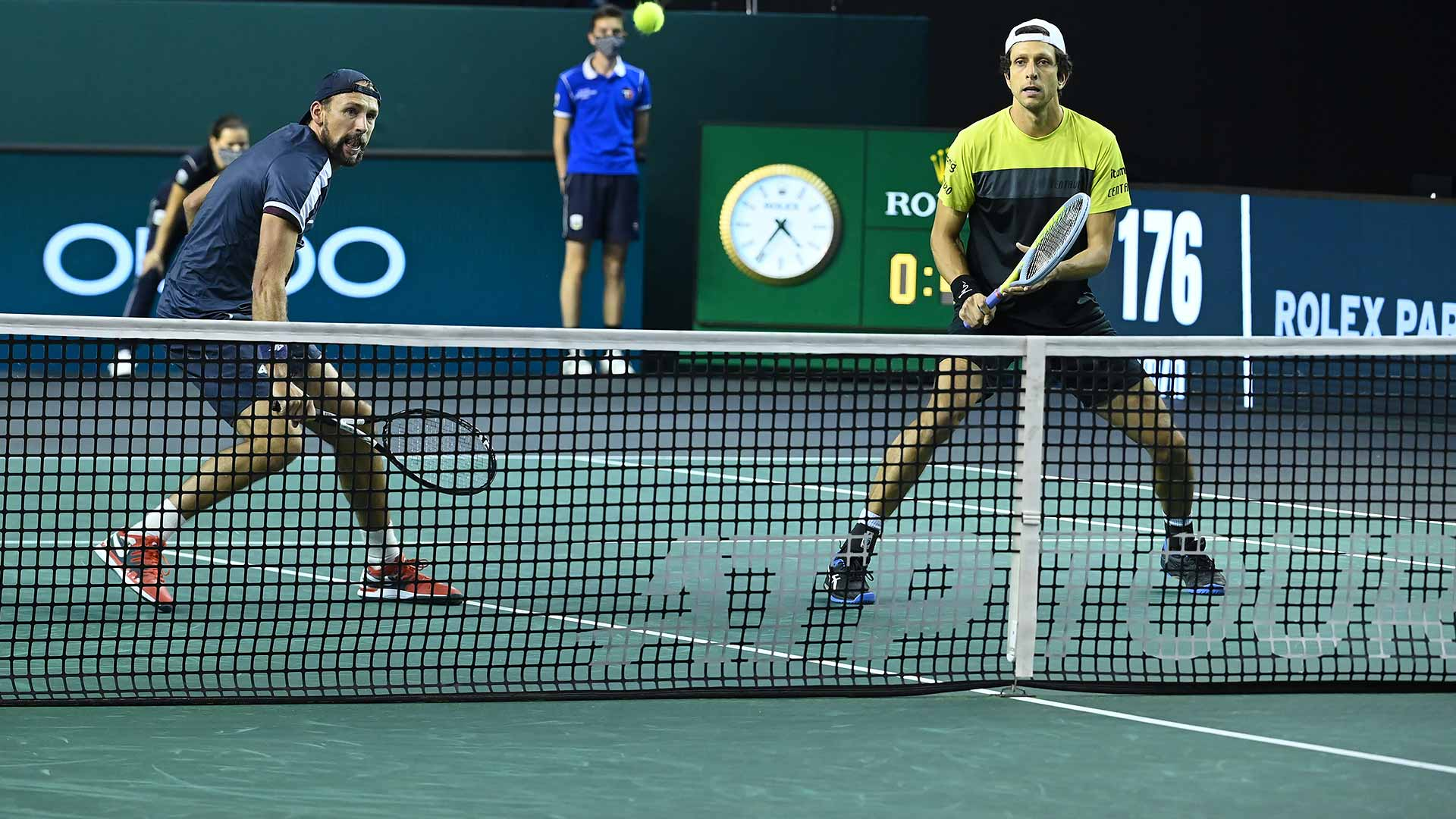 Lukasz Kubot and Marcelo Melo oust defending champions Pierre-Hugues Herbert and Nicolas Mahut in the Paris quarter-finals.