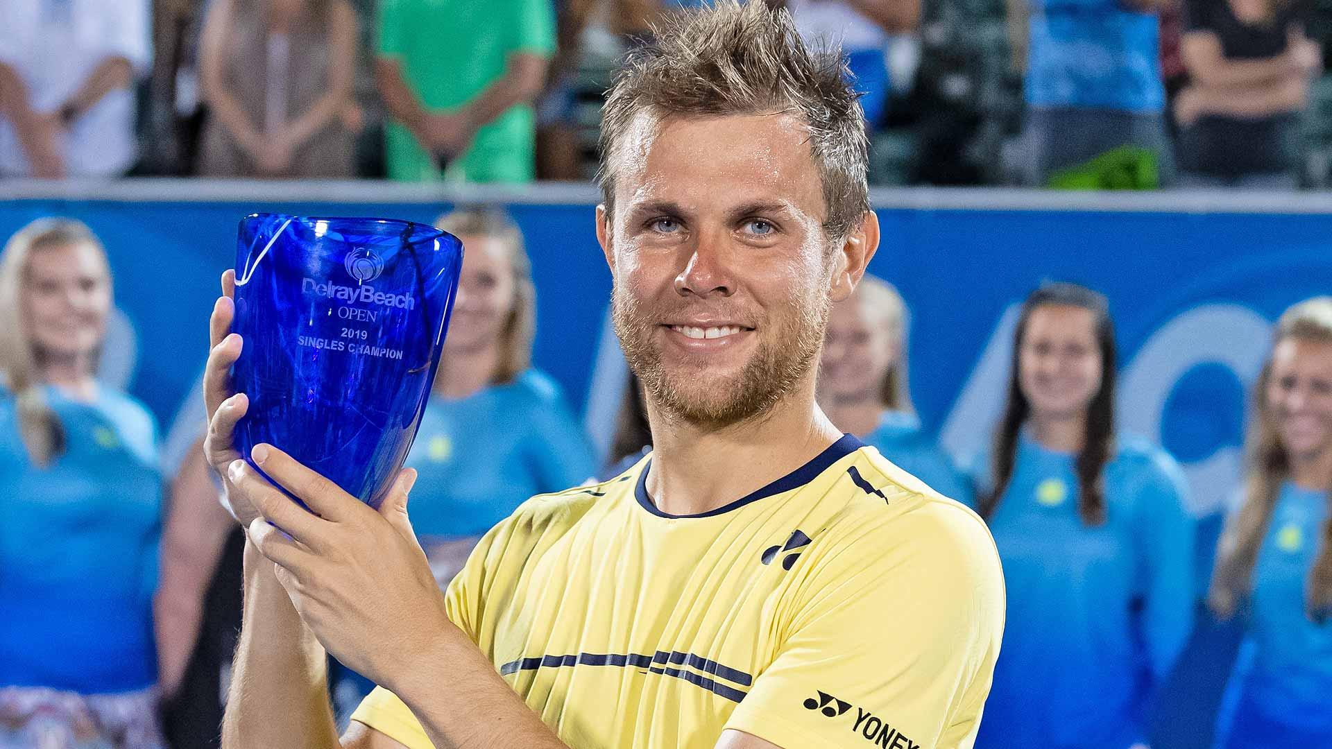 Radu Albot lifts his first ATP Tour trophy.