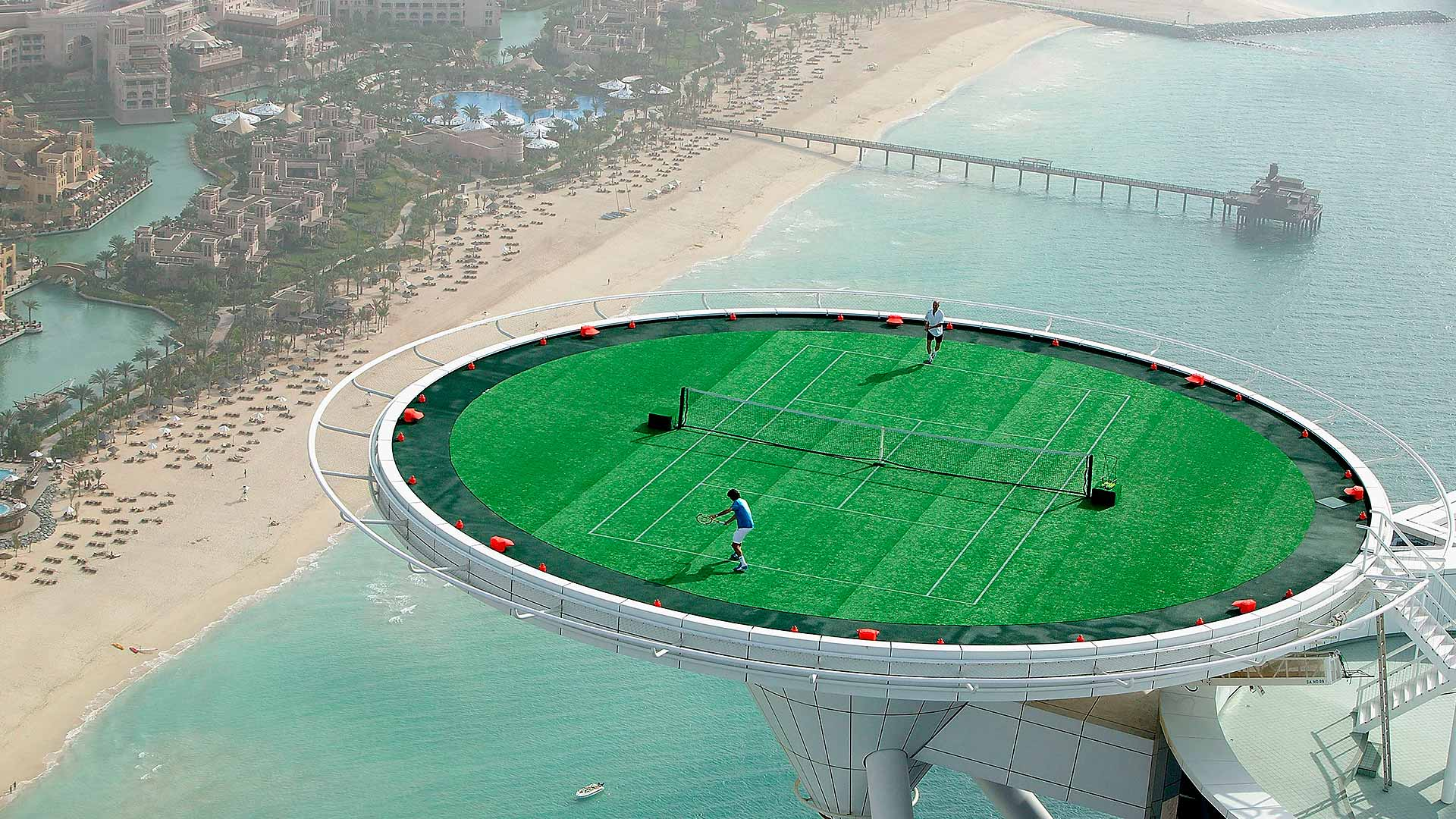 Roger Federer and Andre Agassi have a friendly 'hit' on the helipad of the Burj Al Arab ahead of the 2005 Dubai Duty Free Men's Championship.