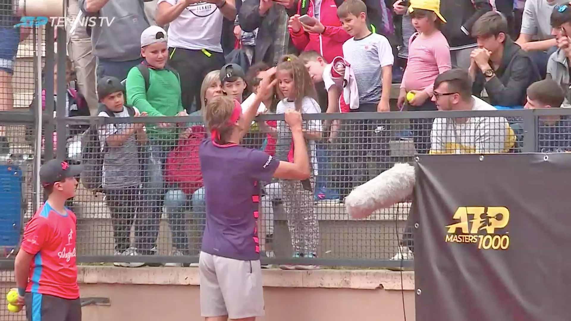 Zverev gives a fan a headband in Rome