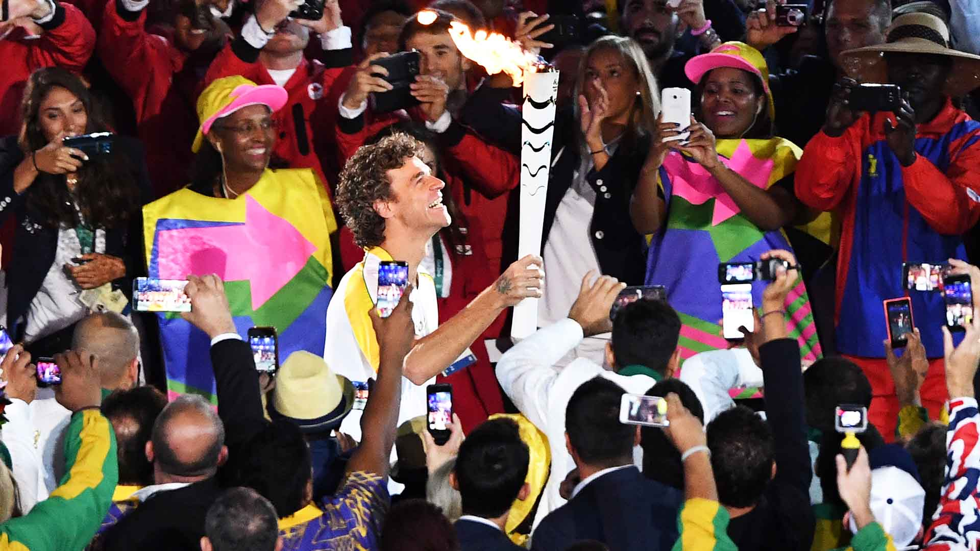 Gustavo Kuerten carries the Olympic flame into the Maracana Stadium at the 2016 Olympic Games in Rio de Janeiro.
