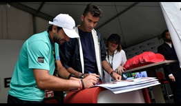 Romanians Florin Mergea and Horia Tecau get up close with their home crowd on Tuesday at the BRD Nastase Tiriac Trophy.