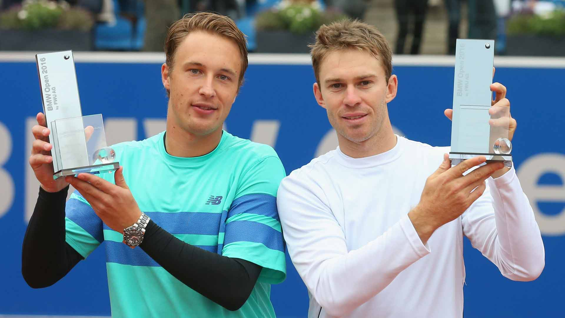 Henri Kontinen and John Peers celebrate winning the doubles title at the 2016 BMW Open by FWU AG.