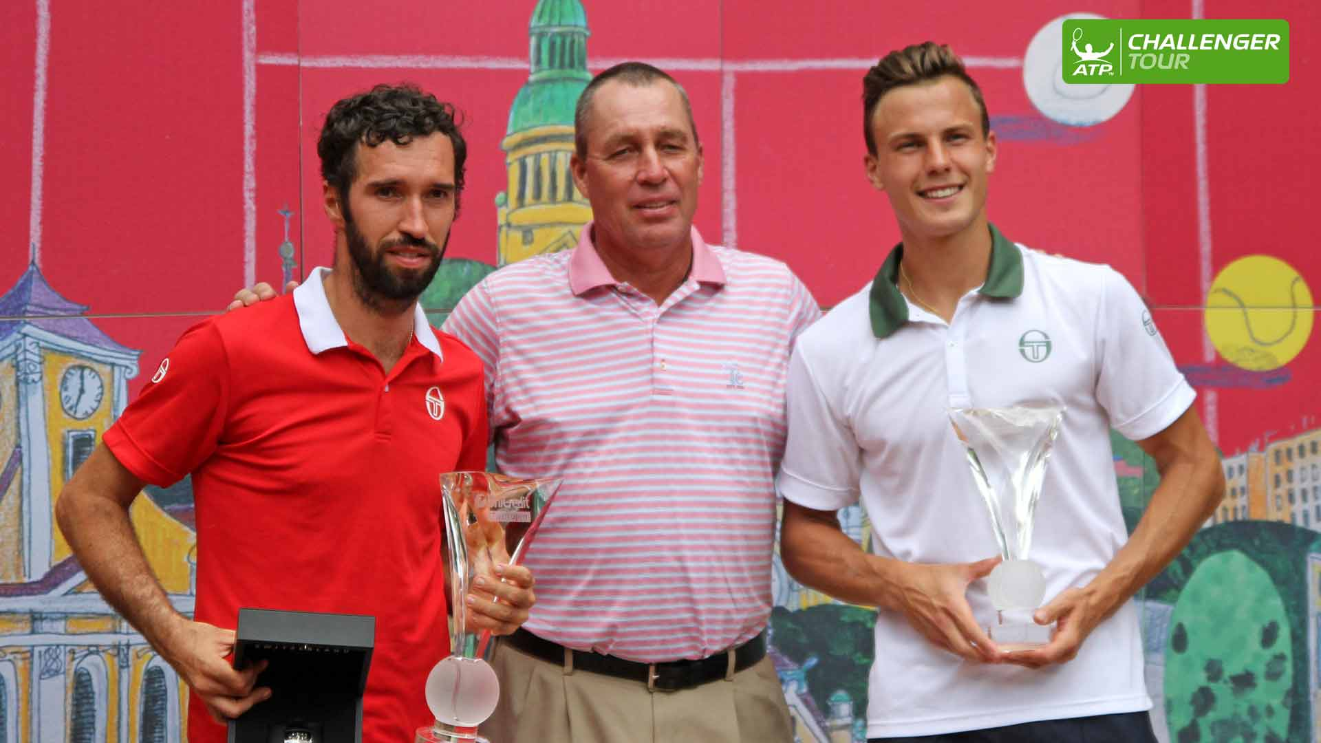 Ivan Lendl presents Mikhail Kukushin (L) and Martin Fucsovics with their trophies in Prostejov.