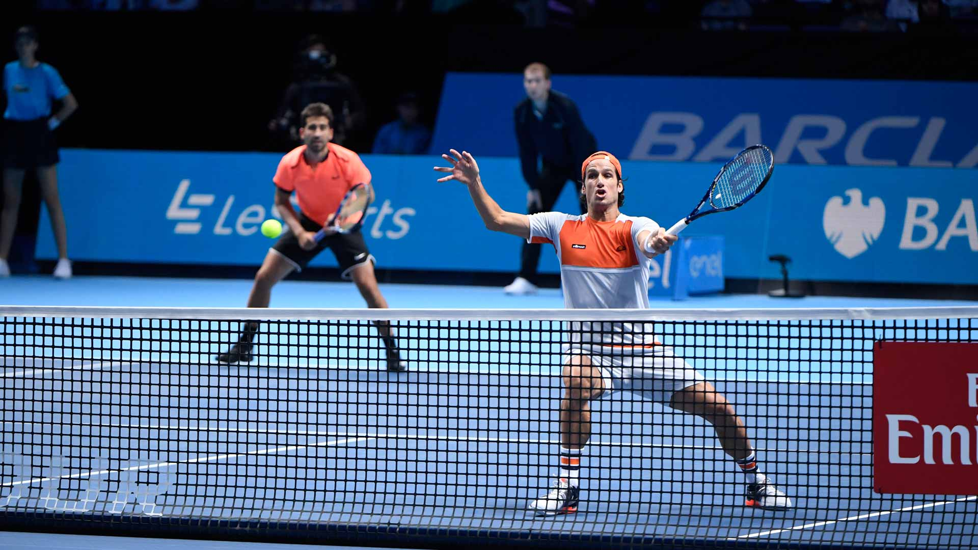 Marc Lopez (L) and Feliciano Lopez stay alive at the Barclays ATP World Tour Finals.