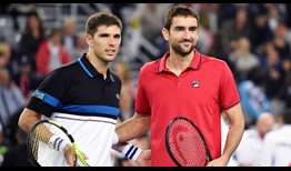 Argentina's Federico Delbonis and Marin Cilic of Croatia pose for photos ahead of the first singles rubber on Friday in the Davis Cup final.