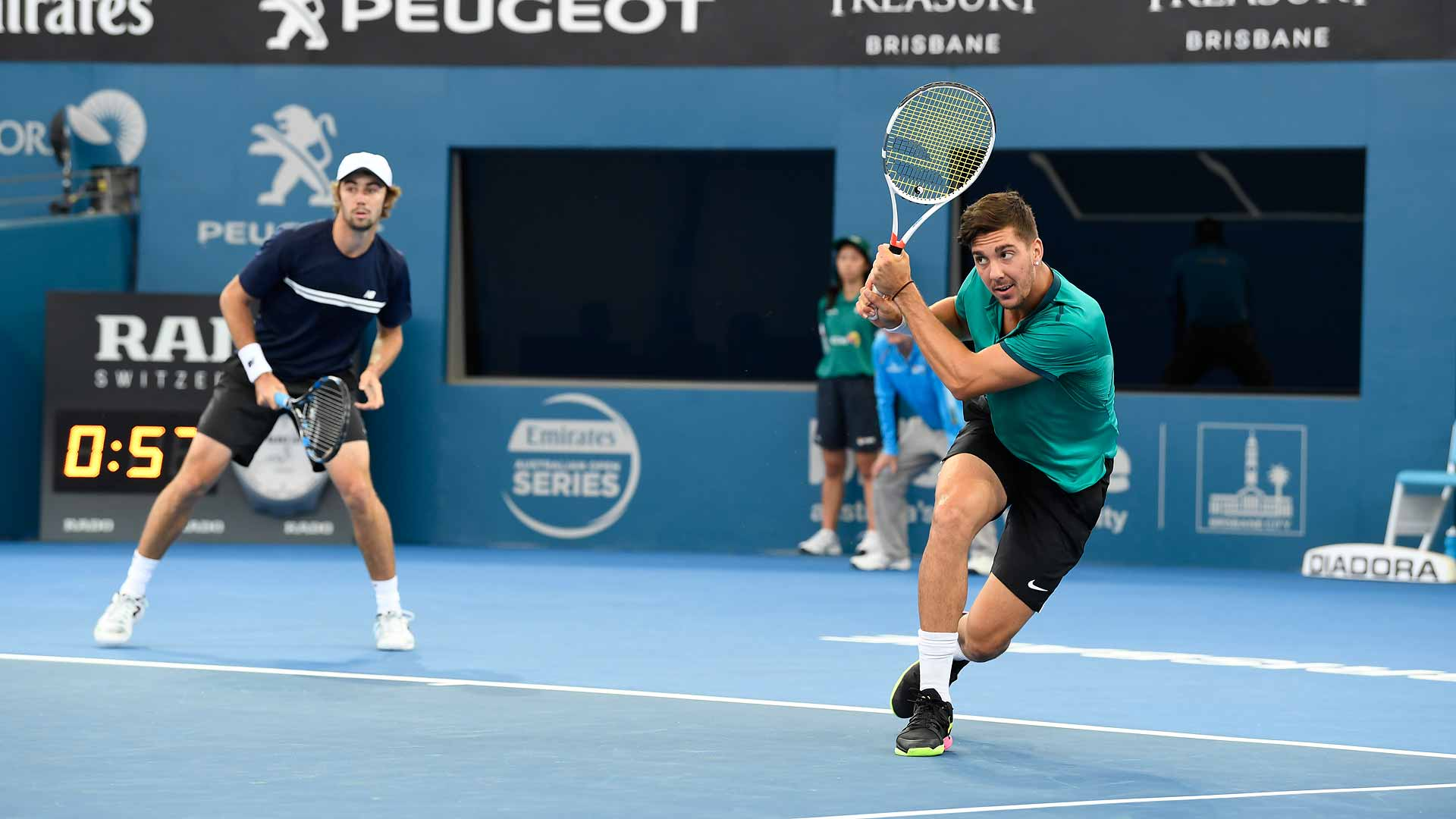 Jordan Thompson (L) and Thanasi Kokkinakis are through to the doubles final in Brisbane.