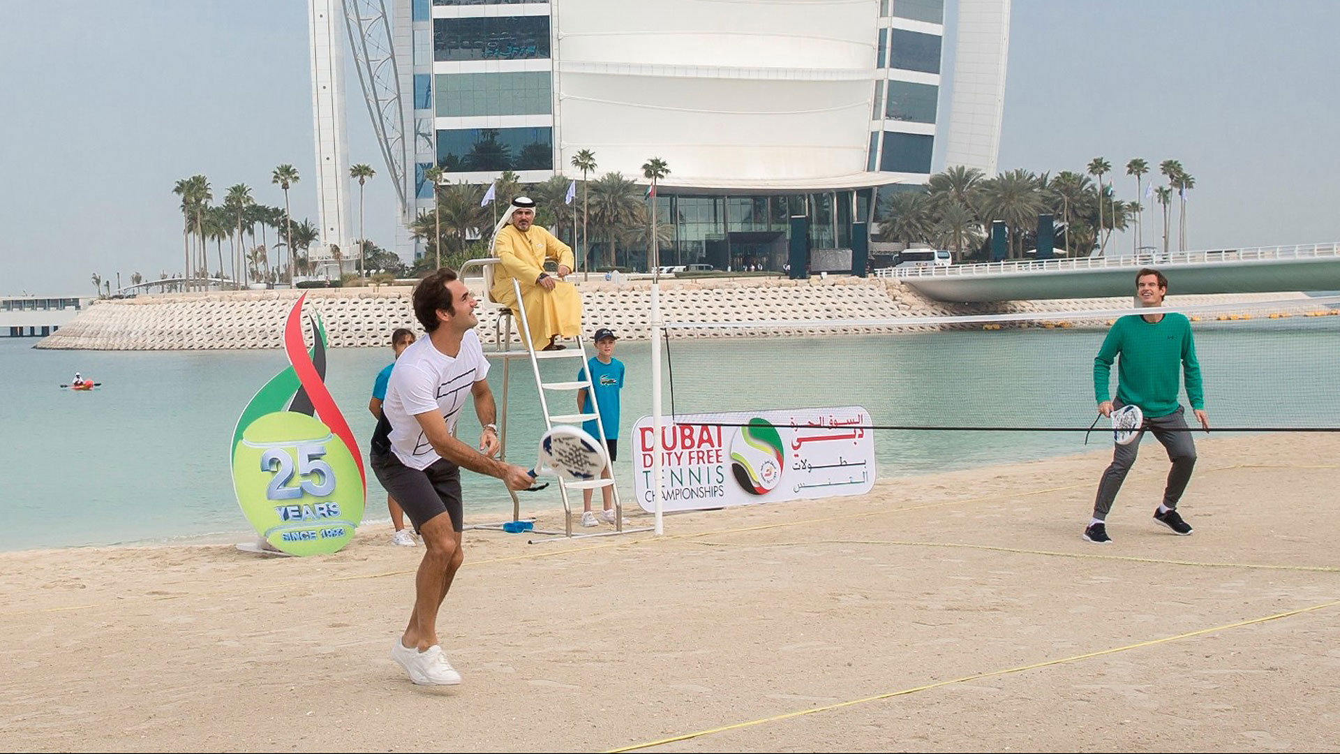 Andy Murray   Overview   ATP World Tour   Tennis Roger Federer and Andy Murray take part in a beach tennis match in front of the iconic Burj Al Arab at the Jumeirah Al Naseem hotel
