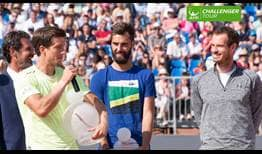 Aljaz Bedene, left, receives a second ATP Challenger Tour trophy of 2017 from World No. 1 Andy Murray.