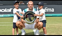 Gilles Muller celebrates a special Father's Day on Sunday by winning the Ricoh Open title with his two sons and other family in attendance.
