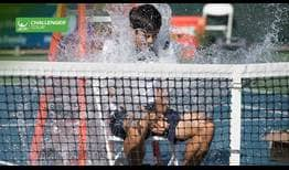 Mackenzie McDonald is dunked after winning his first ATP Challenger Tour title on Sunday in Fairfield, California.