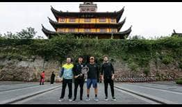 Wu Yibing visits the historic drum tower and former city wall in Ningbo with his coaches and physio.