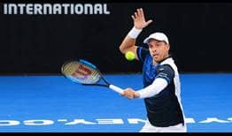 Gilles Muller's title defence in Sydney comes to an end with a loss to Benoit Paire in the quarter-finals.