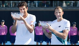 Marcelo Melo and Lukasz Kubot celebrate their ninth ATP World Tour doubles title as a team at the Sydney International.