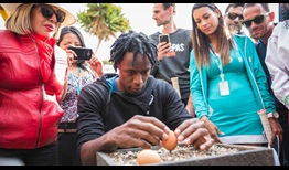 Gael Monfils attempts to balance an egg on top of a nail on the equator ahead of the Ecuador Open in Quito.