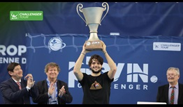 Gregoire Barrere lifts his first ATP Challenger Tour trophy in Lille, France.