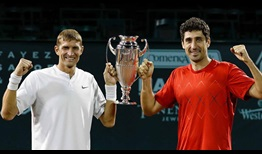 Max Mirnyi and Philipp Oswald lift the trophy in Houston.