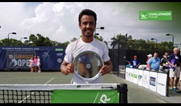 Hugo Dellien lifts his first ATP Challenger Tour trophy, in Sarasota, Florida, USA.