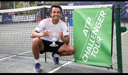 Hugo Dellien lifts his second ATP Challenger Tour trophy after winning on the clay of Savannah.