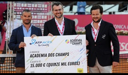 David Massey (centre), Executive Vice President of ATP Europe, presents an ATP ACES for Charity cheque to Academia Champs founder Antonio Champalimaud and Tournament Director Joao Zilhao in Estoril.