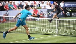 Roger Federer defeats Milos Raonic in straight sets at the MercedesCup to earn his 18th grass-court trophy.