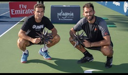 Jean-Julien Rojer and Horia Tecau celebrate back-to-back Winston-Salem Open titles on Friday evening.