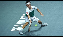 Kei Nishikori reaches his second consecutive semi-final with a three-set win against Georgian Nikoloz Basilashvili.