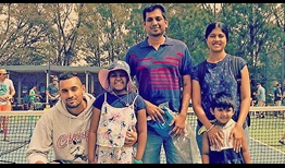 Nick Kyrgios meets Loga Gandhi, her father Pari Gandhi, mother Sankari Kalaiselvan and brother Aylione Gandhi in Canberra on Saturday.