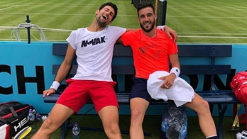 Damir Dzumhur and Novak Djokovic have fun at The Queen's Club in London.