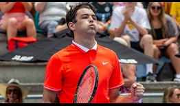 Taylor Fritz celebrates his first win against John Isner in their FedEx ATP Head2Head series.