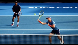 Raven Klaasen and Michael Venus (volleying) sweep into the Auckland final on Friday after beating Bob and Mike Bryan.