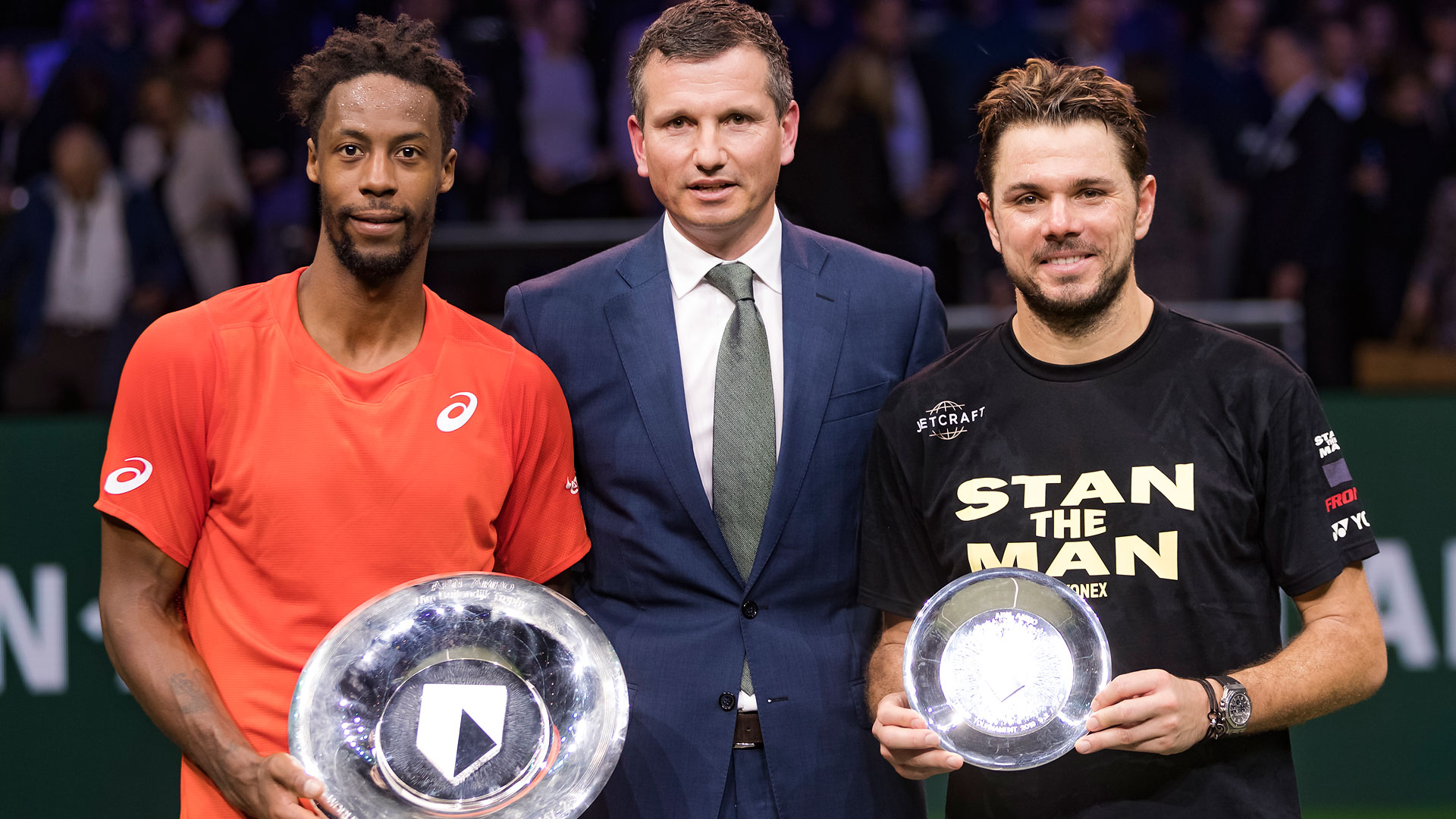 Gael Monfils beat Stan Wawrinka (right) in the 2019 ABN AMRO World Tennis Tournament final. They pose for photos with Tournament Director Richard Krajicek.
