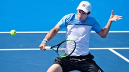 Mackenzie McDonald hits a backhand volley during his first-round win against Taylor Fritz at the Delray Beach Open.