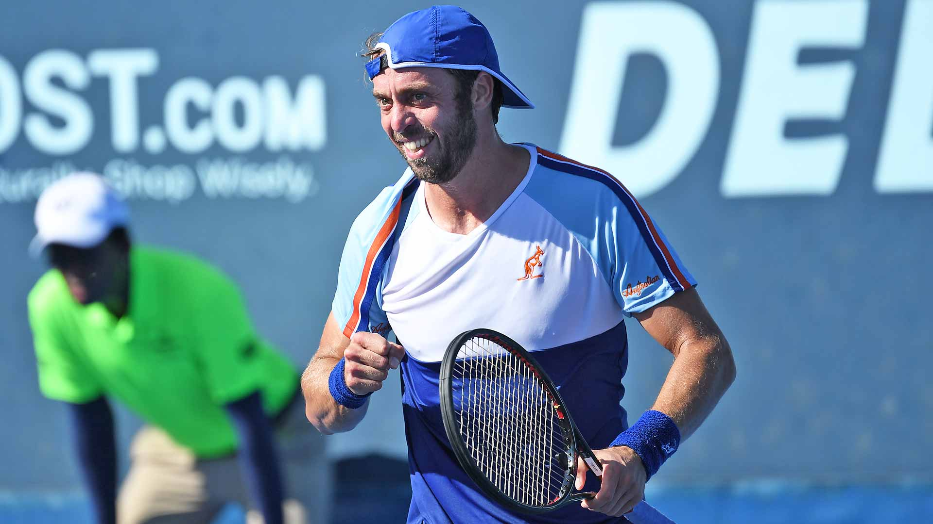Paolo Lorenzi pumps his fist during his first-round win at the Delray Beach Open presented by VITACOST.com.
