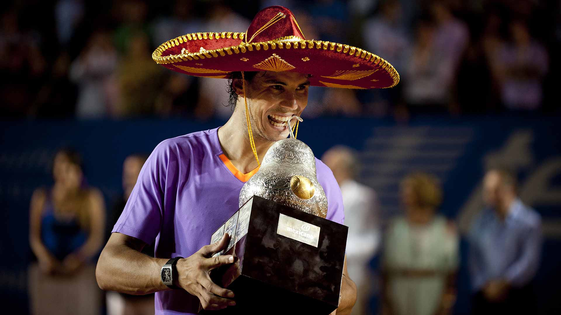 Rafael Nadal celebrates his second Acapulco trophy after defeating countryman David Ferrer in the 2013 final.