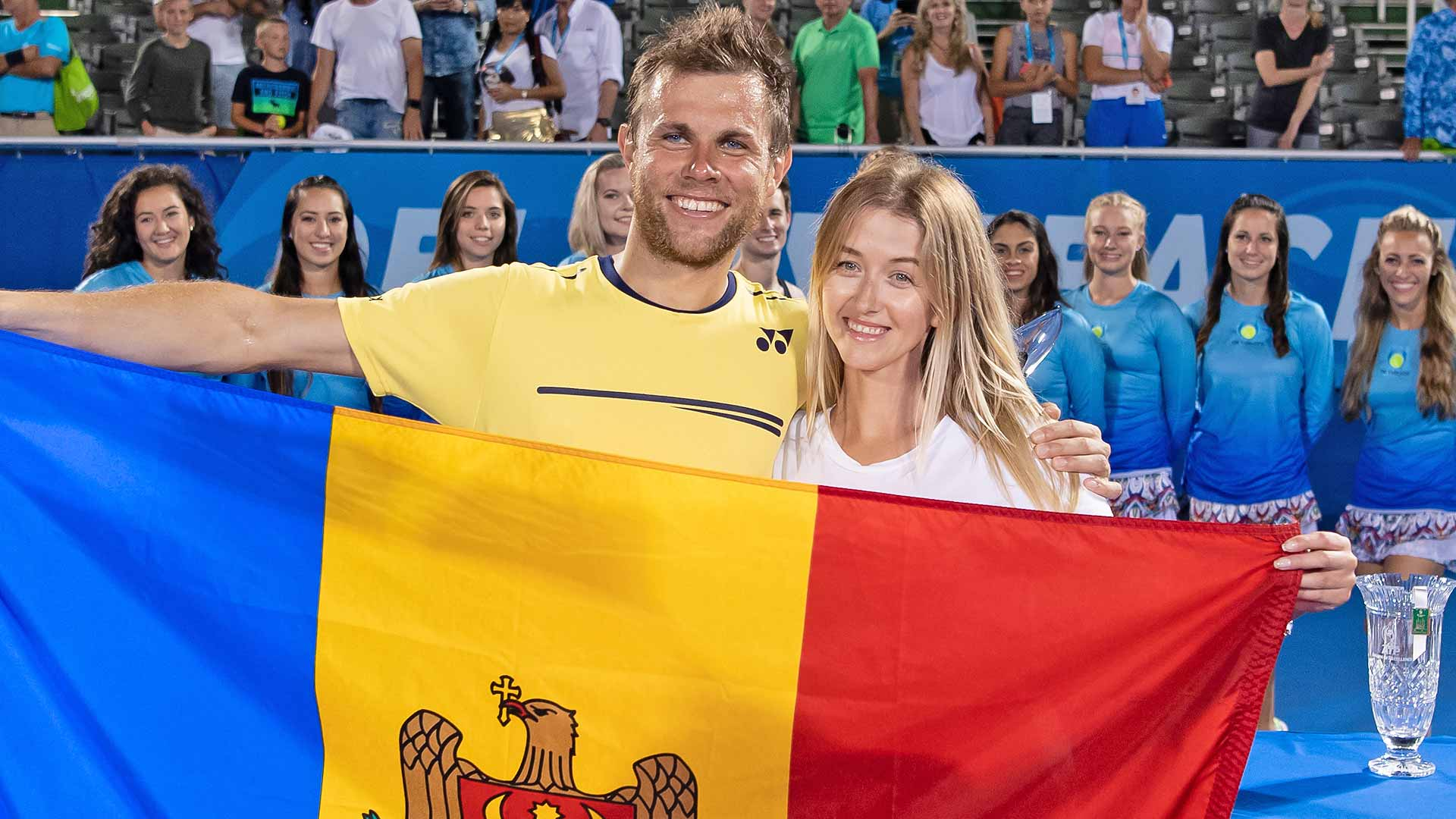Radu Albot celebrates his first ATP Tour title with his girlfriend in Delray Beach.