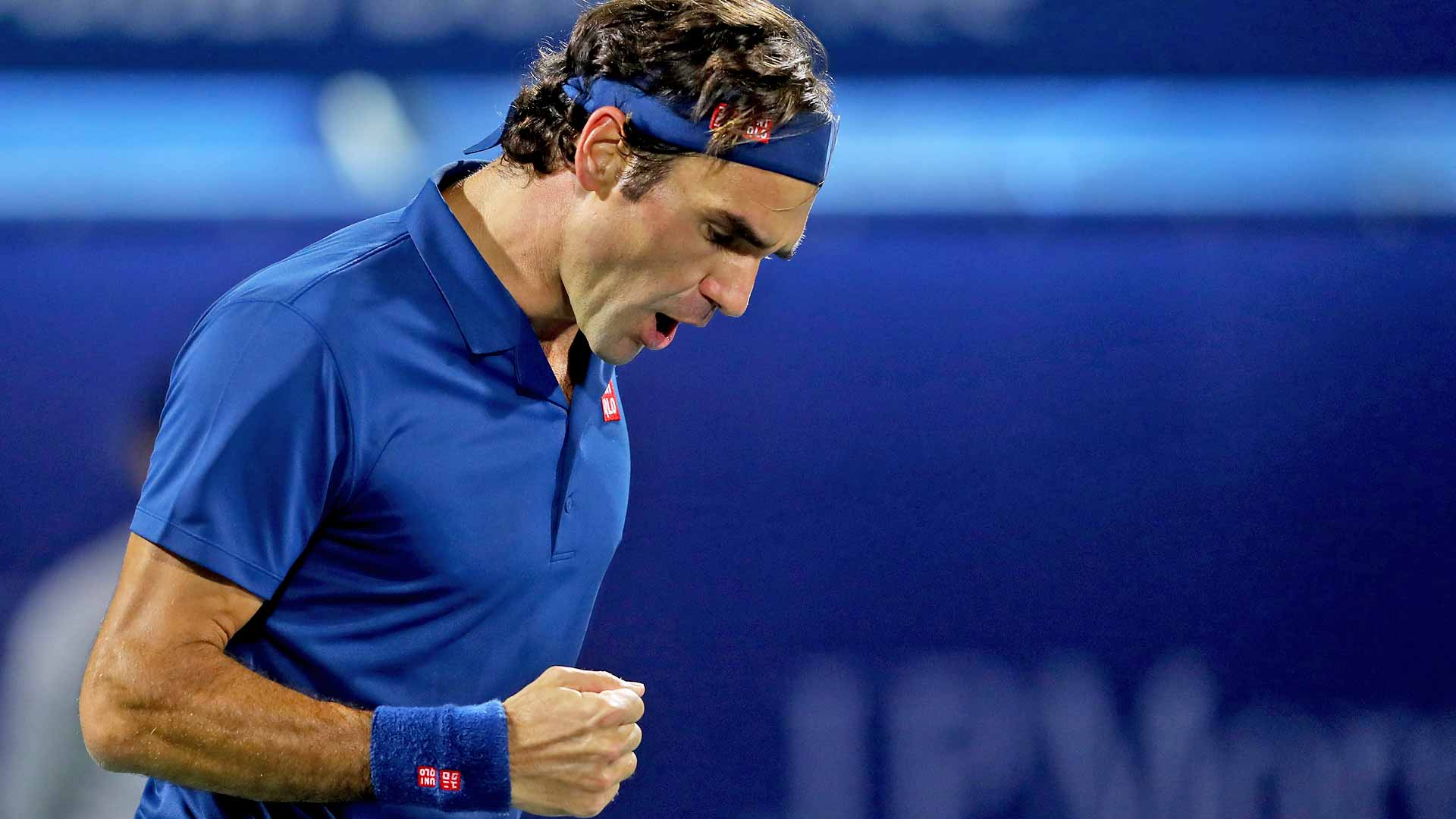 Roger Federer pumps his fist during his victory against Stefanos Tsitsipas in the Dubai final