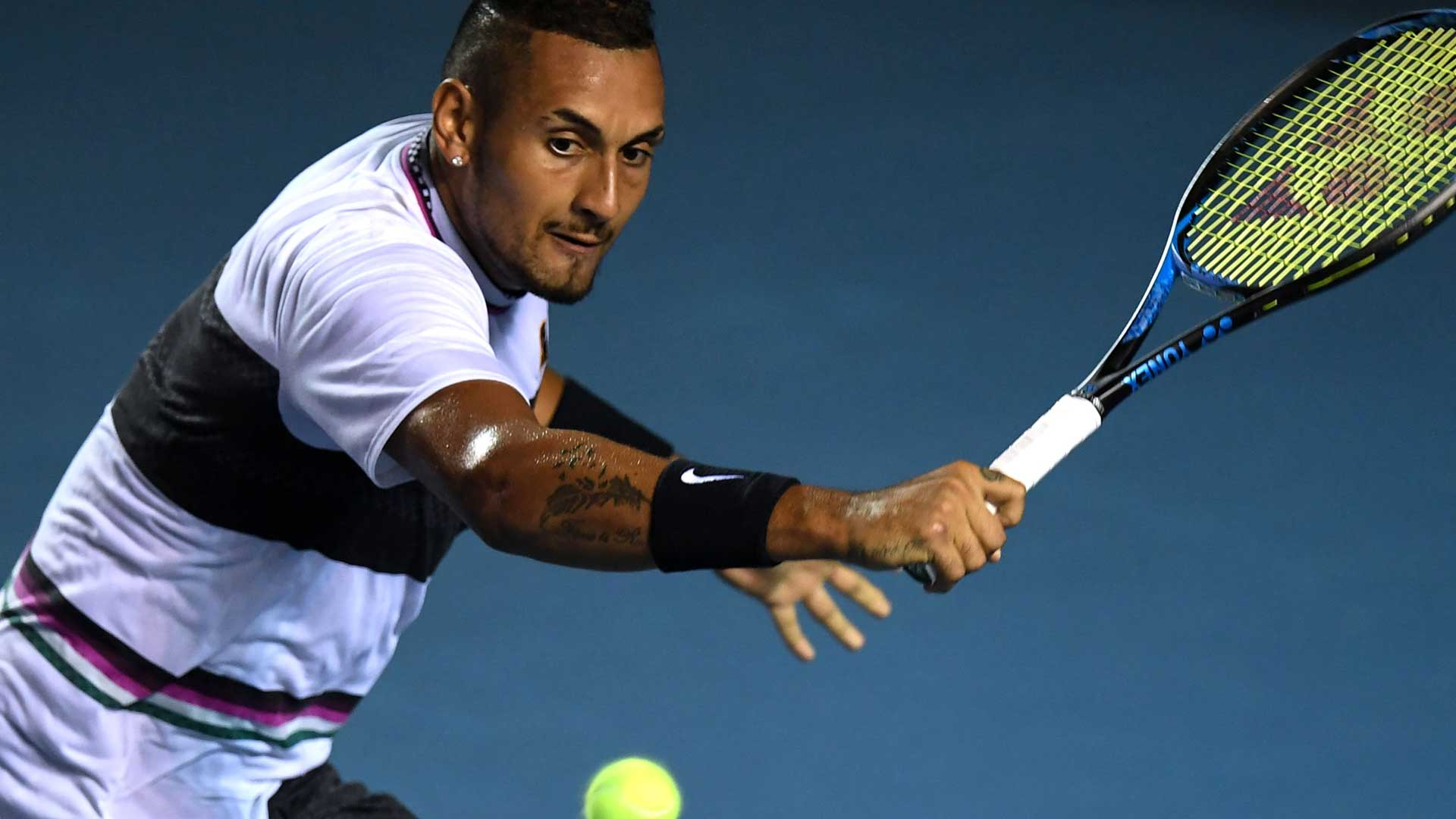 Nick Kyrgios hits a backhand in Acapulco.
