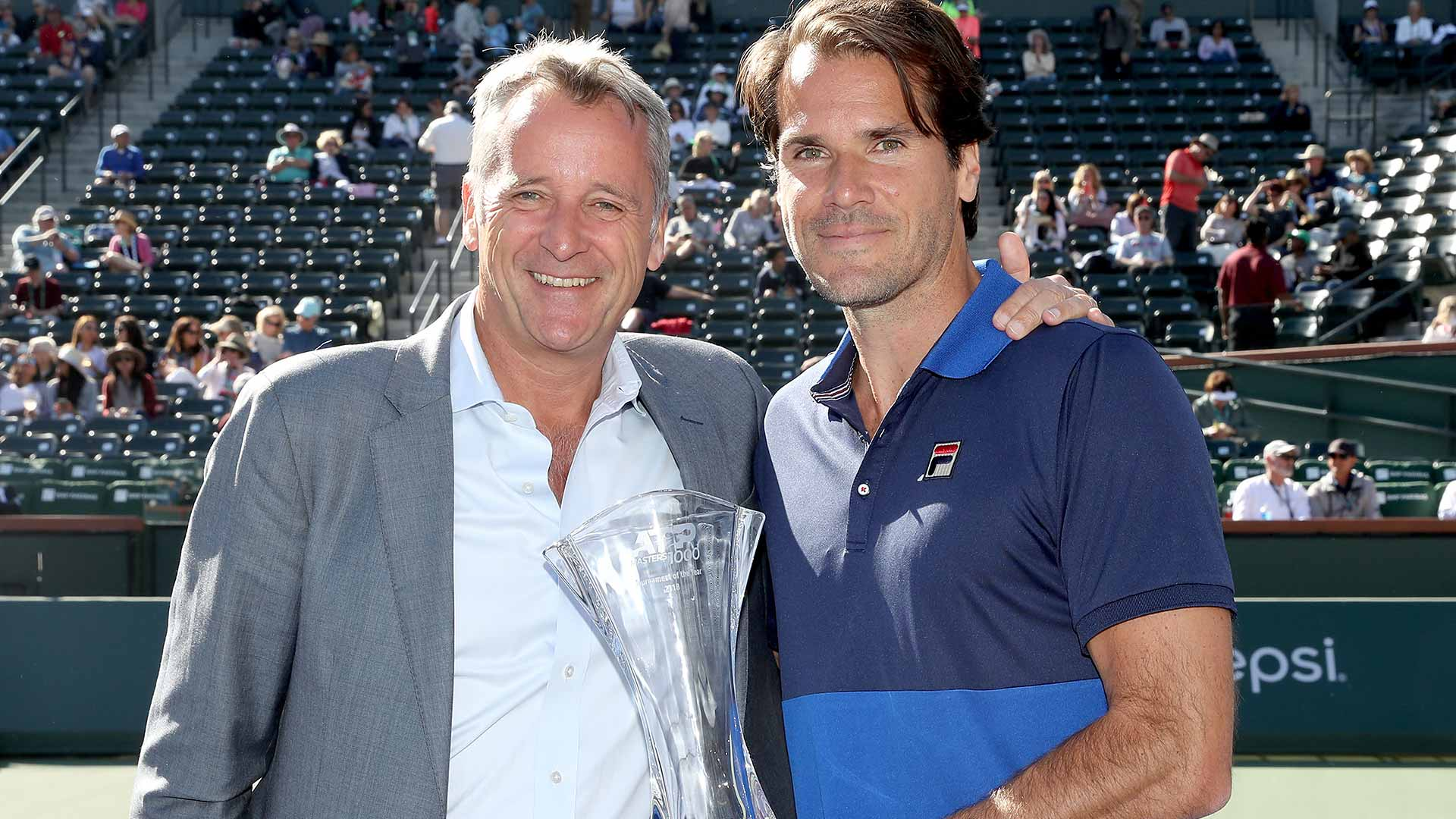 ATP Executive Chairman & President <a href='https://www.atptour.com/en/players/chris-kermode/k007/overview'>Chris Kermode</a> presents <a href='https://www.atptour.com/en/tournaments/indian-wells/404/overview'>BNP Paribas Open</a> Tournament Director <a href='https://www.atptour.com/en/players/tommy-haas/h355/overview'>Tommy Haas</a> with the ATP Masters 1000 Tournament of the Year trophy in the 2018 ATP Awards.