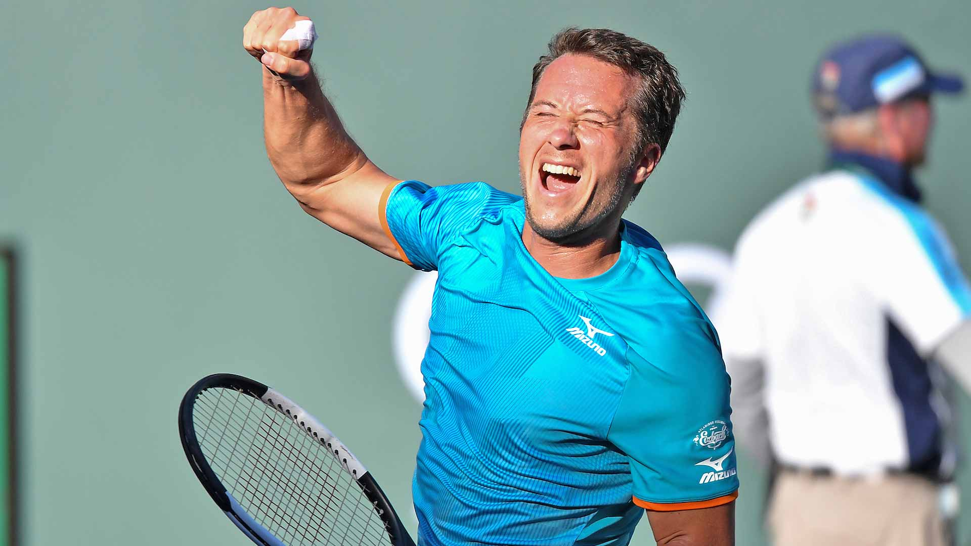 Philipp Kohlschreiber celebrates his win against Novak Djokovic at the 2019 BNP Paribas Open