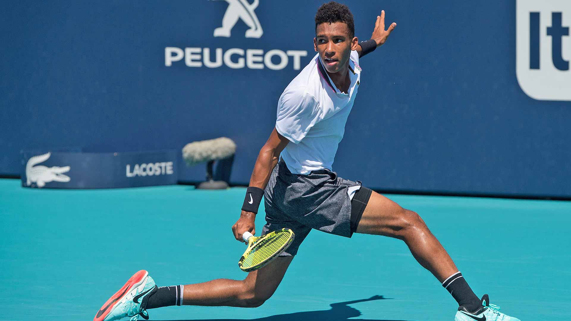 Felix Auger-Aliassime hits a slice against Nikoloz Basilashvili in Miami