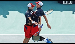Mike Bryan and Bob Bryan save four match points en route to the Miami final.