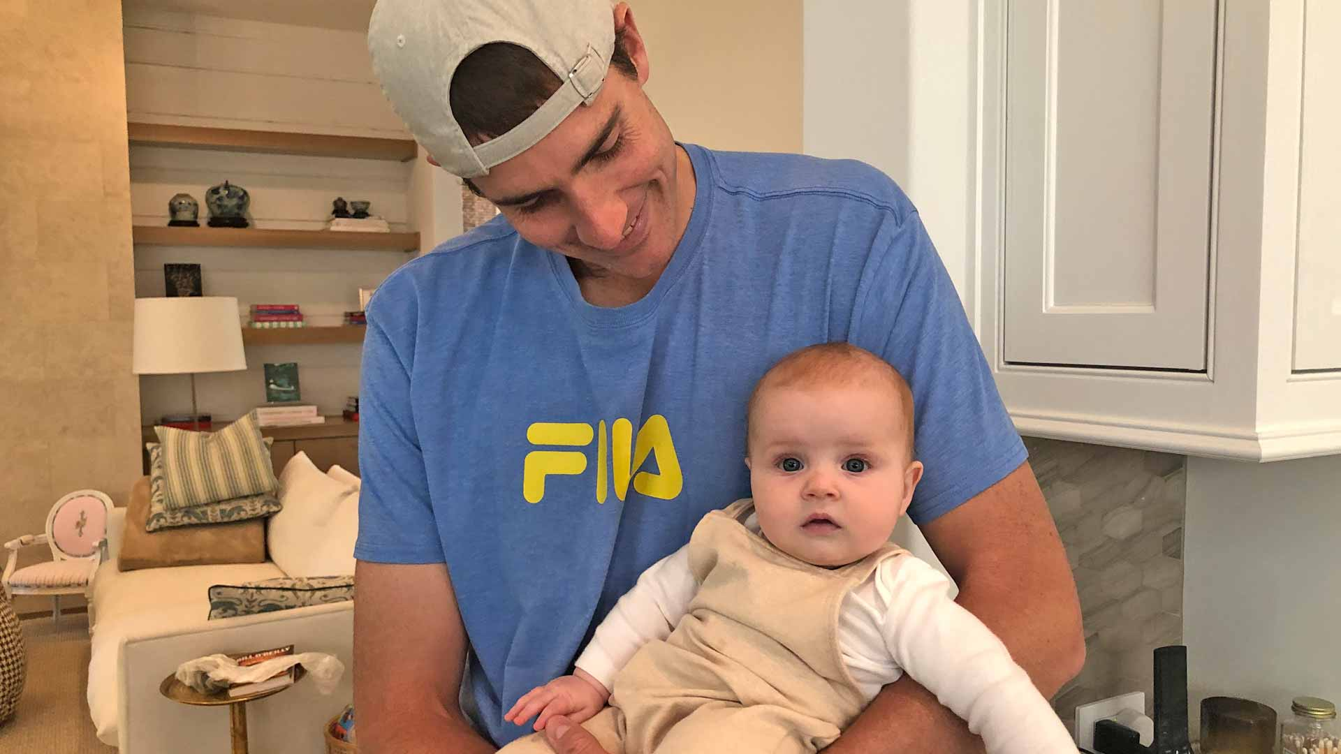 John Isner with daughter Hunter Grace