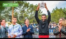 Dustin Brown celebrates his eighth ATP Challenger Tour title, presented with the trophy by WTA legend Mary Pierce in Sophia Antipolis, France.