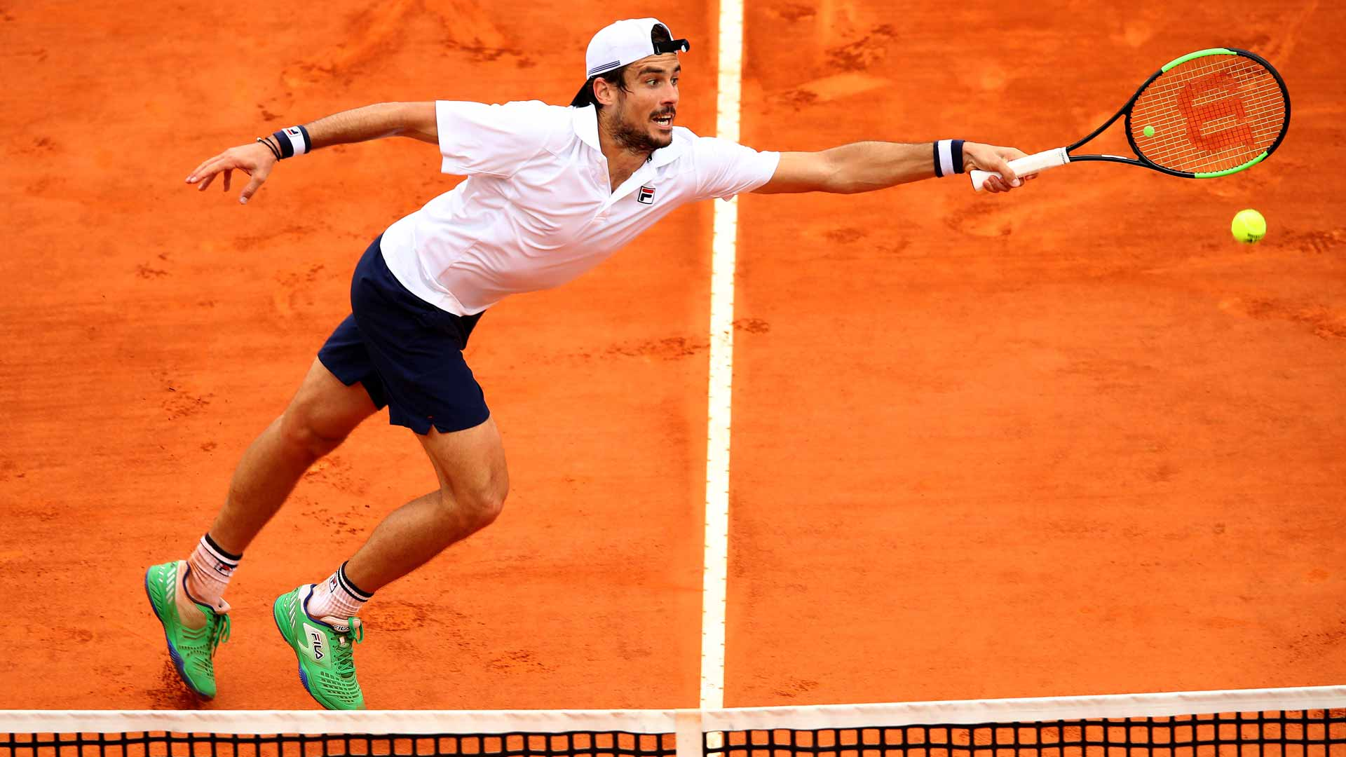 Guido Pella hits a volley against Marin Cilic in Monte-Carlo