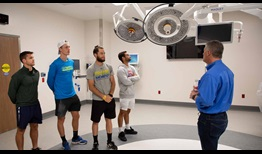 Marc Polmans, Noah Rubin, Anderson Reed and Hunter Reese visit the Vogter Neuro Intensive Care Unit in Tallahassee.