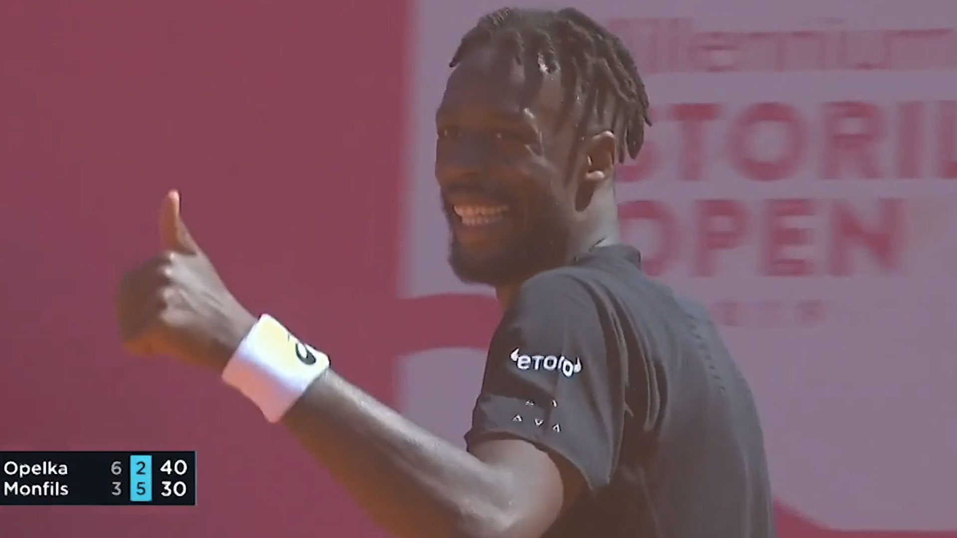 Gael Monfils reacts to Reilly Opelka's bizarre ace at the Millennium Estoril Open on Wednesday.