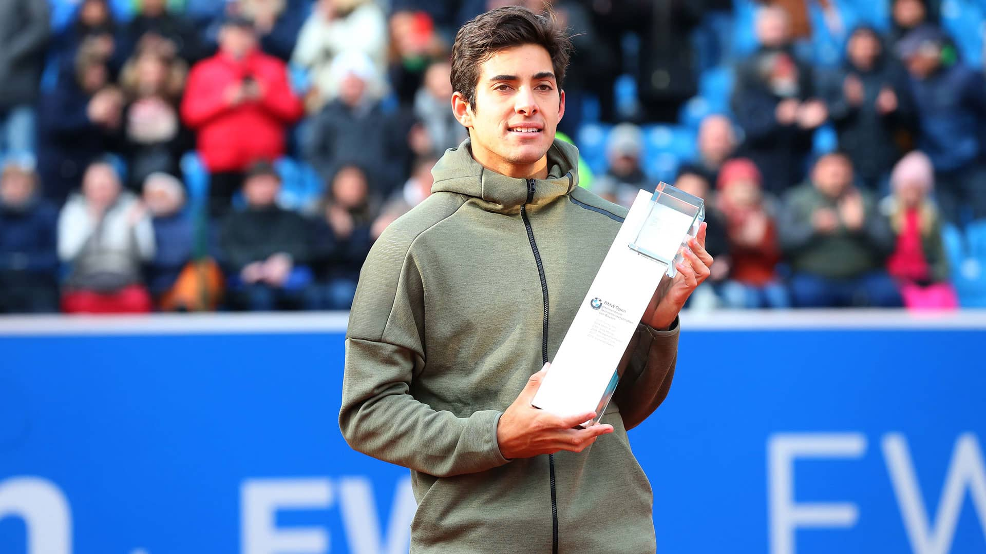 Cristian Garin hoids the winner's trophy in Munich.