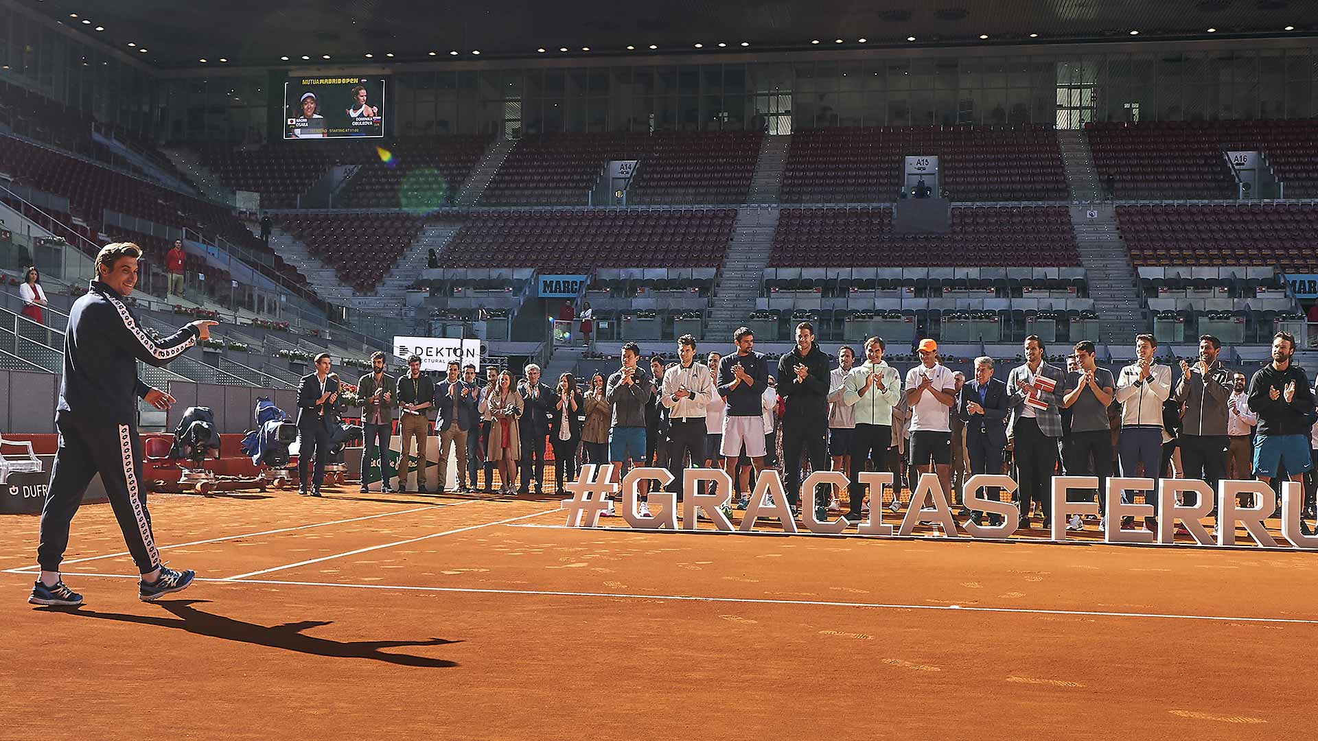 <a href='https://www.atptour.com/en/players/david-ferrer/f401/overview'>David Ferrer</a> walks on court at La Caja Magica for a special ceremony in his honour ahead of his final tournament in Madrid
