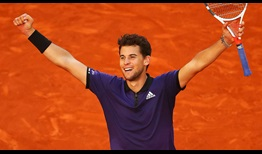 Dominic Thiem celebrates beating Roger Federer in Madrid on Friday after saving two match points in the second set tie-break.